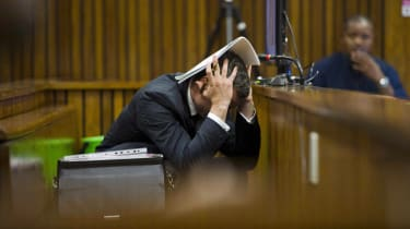 PRETORIA, SOUTH AFRICA - MARCH 13 (SOUTH AFRICA OUT):Oscar Pistorius at the Pretoria High Court on March 13, 2014, in Pretoria, South Africa. Pistorius, stands accused of the murder of his gi