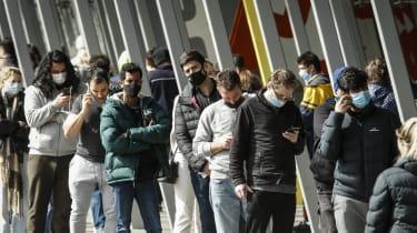 Australians queue for vaccination outside the Melbourne Exhibition Centre