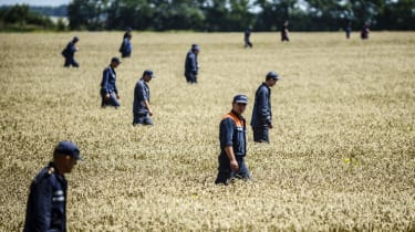 Members of theUkrainian State Emergency Service search for bodies in a field near the crash site of the Malaysia Airlines Flight MH17 near the village of Hrabove (Grabove), in Donetsk region