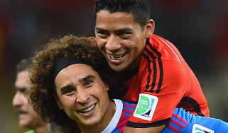 Goalkeeper Guillermo Ochoa of Mexico celebrates