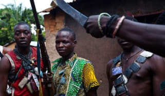 Anti-Balaka fighters show their weapons outside Bangui