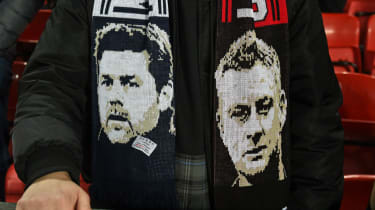 A supporter wears a scarf showing ex-Tottenham boss Mauricio Pochettino and Manchester United manager Ole Gunnar Solskjaer