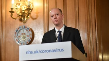 Chief Medical Officer Chris Whitty speaks during a press conference with Boris Johnson