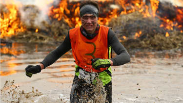 WOLVERHAMPTON, ENGLAND - FEBRUARY 01:A competitor jumps through the fire pits during the Tough Guy Challenge at South Perton Farm on February 1, 2015 in Wolverhampton, England.(Photo by Richa