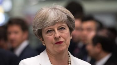 Theresa May vows to stay on as leader after Brexit