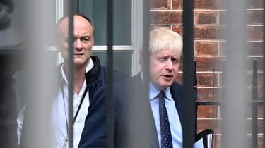 Boris Johnson and Dominic Cummings leave Downing Street
