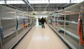 Empty shelves at a Manchester supermarket in March