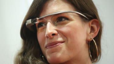 A woman wears Google Glass