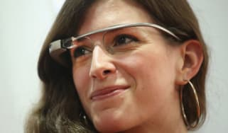 A woman wears Google Glass