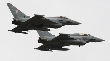 Two RAF Typhoon fighter jets in action