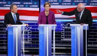 LAS VEGAS, NEVADA - FEBRUARY 19: Democratic presidential candidate Sen. Bernie Sanders (I-VT) (R) gestures as Sen. Elizabeth Warren (D-MA) and former New York City mayor Mike Bloomberg listen