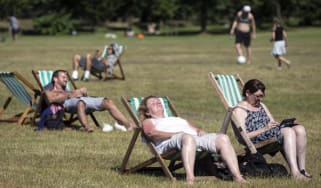 People enjoy the weather in Hyde Park