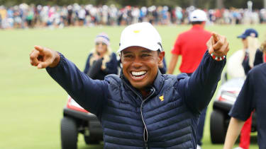 Team United States captain Tiger Woods celebrates during the Presidents Cup