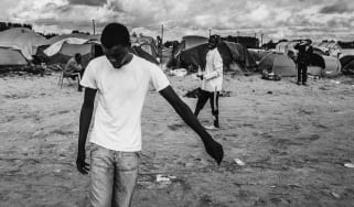 A group of migrants playing football in the camp