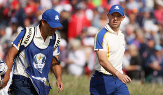 Rory McIlroy walks with his caddie during the 43rd Ryder Cup