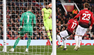 Luis Suarez's header was deflected into his own net by Manchester United's Luke Shaw