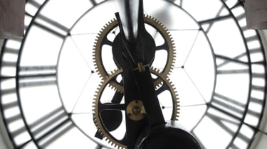 SINGAPORE - JULY 17:Details of the clock mechanism is seen inside the clock tower during the media preview of the Victoria Theatre and Concert Hall on July 17, 2014 in Singapore. The Victoria