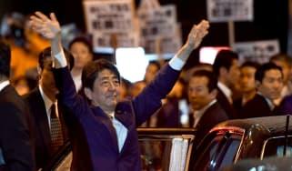 Prime Minister Shinzo Abe celebrates his landslide victory