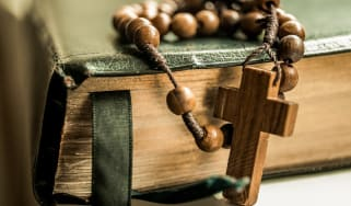 Rosary beads on a bible
