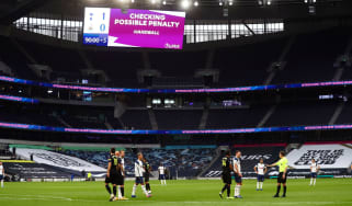 Peter Bankes awaits confirmation of a penalty from VAR during the Premier League match between Tottenham and Newcastle