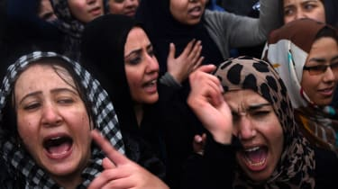 Afghan demonstrators shout slogans during a rally in front of the Supreme Court in Kabul on March 24, 2015, held to protest the killing of Afghan resident Farkhunda. More than a thousand peop