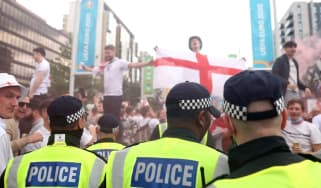 Police and England fans on Wembley Way ahead of the Euro 2020 final