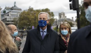 EU Brexit negotiator Michel Barnier walks with members of the EU delegation in London.