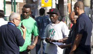 Israeli immigration officers checking African migrants
