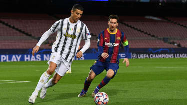 Cristiano Ronaldo in action for Juventus against Lionel Messi of Barcelona