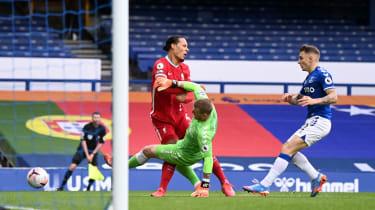 Liverpool star Virgil van Dijk was injured following this tackle by Everton goalkeeper Jordan Pickford