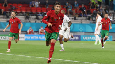 Portugal captain Cristiano Ronaldo celebrates his second penalty against France