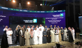 (EDITORS NOTE: Best quality available, image shot using a smartphone.) Participants attend the initial public offering (IPO) of Saudi Aramco at the Fairmont Hotel in Riyadh, Saudi Arabia, on