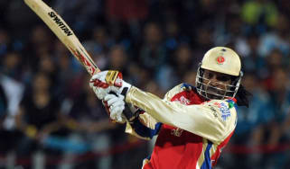 Royal Challengers Bangalore Chris Gayle plays a shot during the IPL Twenty20 cricket match between Pune Warriors India and Royal Challengers Bangalore at The Subroto Roy Sahara Stadium in Pun