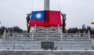 Honour guards prepare to raise the Taiwan flag in the Chiang Kai-shek Memorial Hall square