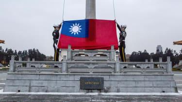 Honour guards prepare to raise the Taiwan flag in the Chiang Kai-shek Memorial Hall square