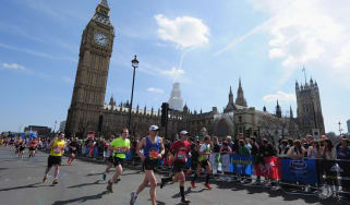 Competitors pass Westminster during the London Marathon