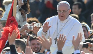 Pope Francis waves to the crowd from the papamobile during his inauguration mass at St Peter's square on March 19, 2013 at the Vatican. World leaders flew in for Pope Francis's inauguration m