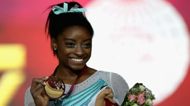 USA gymnast Simone Biles celebrates her gold in the women's all-around final in Doha