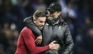 Liverpool manager Jurgen Klopp celebrates with captain Jordan Henderson after winning in Porto