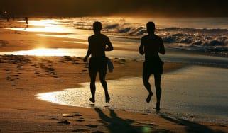Joggers on beach