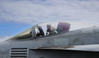 A US navy pilot prepares to take off from the USS George H. W. Bush