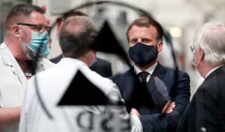 President Macron wearing a mask during a visit to a car factory