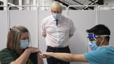 Boris Johnson watching an NHS first responder getting her vaccination