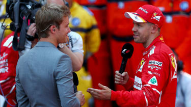 F1 2016 world champion Nico Rosberg talks with Ferrari driver Sebastian Vettel