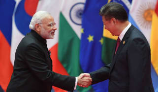 India's Prime Minister Narendra Modi shakes hands with China's President Xi Jinping