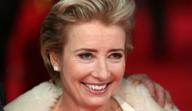 British actress Emma Thompson arrives on the red carpet for the BAFTA British Academy Film Awards at the Royal Opera House in London on February 16, 2014. AFP PHOTO / ANDREW COWIE(Photo credi