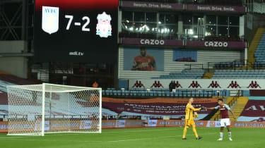 Liverpool goalkeeper Adrian bumps fists with Aston Villa hat-trick hero Ollie Watkins