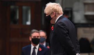 Boris Johnson passes by Keir Starmer as they attend a service to mark Armistice Day