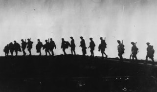 The silhouette of WWI troops as they march towards the front line