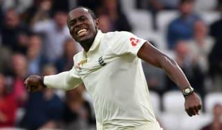 England's Jofra Archer celebrates taking the wicket of Australia batsman Pat Cummins